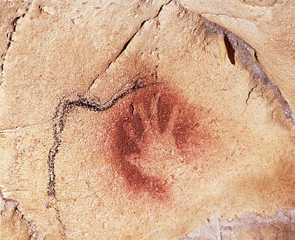 Một dấu tay con người có niên đại từ 30.000 năm trước trên tảng đá ở hang Chauvet-Pont-d'Arc miền Nam nước Pháp.